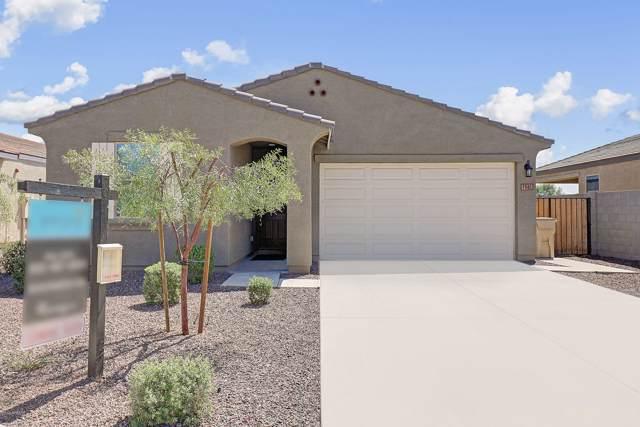 1961 N 214TH Drive, Buckeye, AZ 85396 (MLS #5976500) :: Riddle Realty Group - Keller Williams Arizona Realty