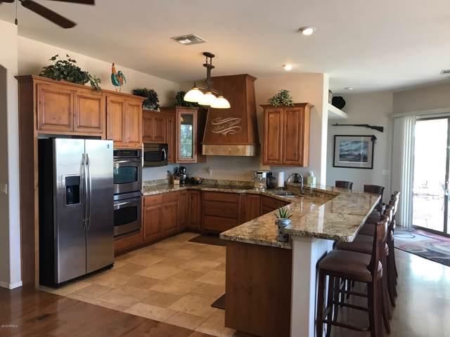 9043 W Camino De Oro, Peoria, AZ 85383 (MLS #5980517) :: Homehelper Consultants