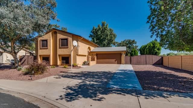 1205 N Raven, Mesa, AZ 85207 (MLS #6001827) :: The Laughton Team