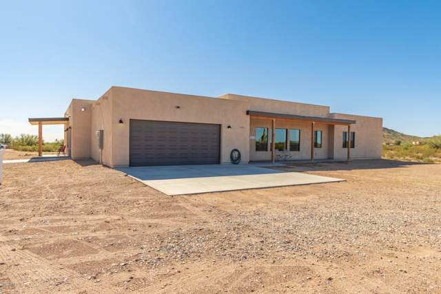 14431 W Dynamite Boulevard, Surprise, AZ 85387 (MLS #6002516) :: Devor Real Estate Associates