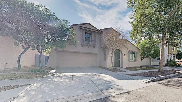 5225 W Albeniz Place, Phoenix, AZ 85043 (MLS #6002752) :: Brett Tanner Home Selling Team