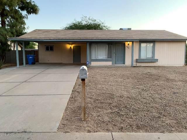 4627 E Pollack Lane, Phoenix, AZ 85042 (MLS #6007227) :: Devor Real Estate Associates
