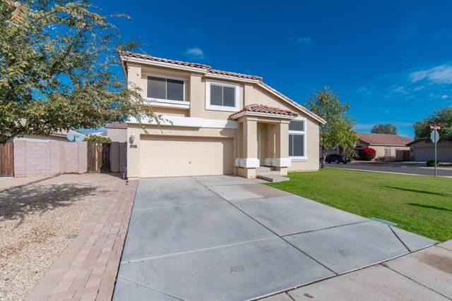 15734 W Ventura Street, Surprise, AZ 85379 (MLS #6011825) :: Yost Realty Group at RE/MAX Casa Grande