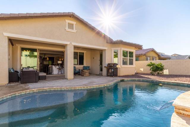 20720 W Carlton Manor Manor, Buckeye, AZ 85396 (MLS #6028600) :: Devor Real Estate Associates