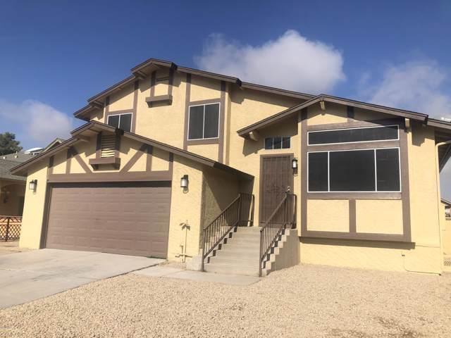 8912 W Sheridan Street, Phoenix, AZ 85037 (MLS #6028619) :: Yost Realty Group at RE/MAX Casa Grande
