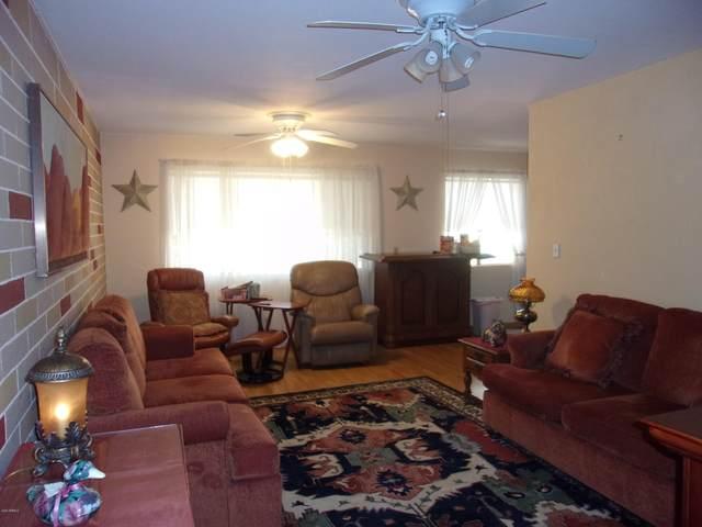8220 E Garfield Street M207, Scottsdale, AZ 85257 (MLS #6034547) :: Riddle Realty Group - Keller Williams Arizona Realty
