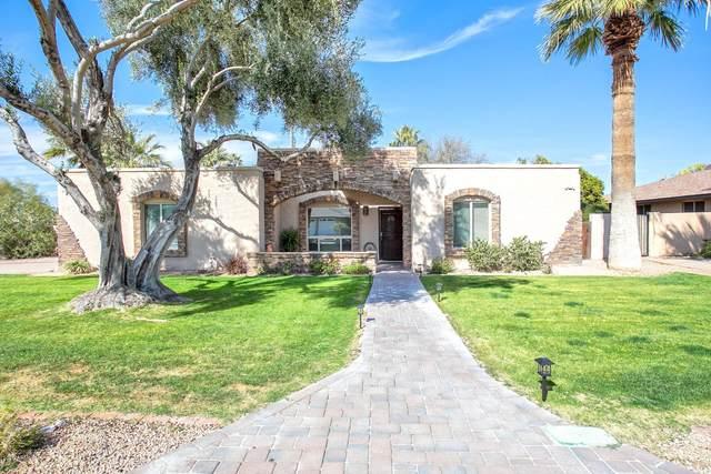 122 E Surrey Avenue, Phoenix, AZ 85022 (MLS #6037006) :: Devor Real Estate Associates