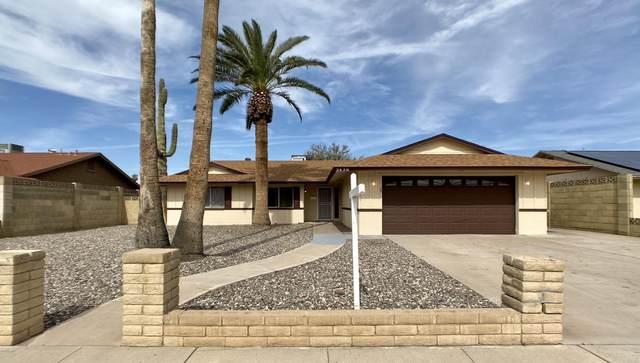 3438 W Gelding Drive, Phoenix, AZ 85053 (MLS #6040665) :: The W Group