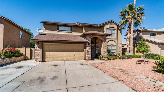 8722 W Virginia Avenue, Phoenix, AZ 85037 (MLS #6057972) :: The Laughton Team