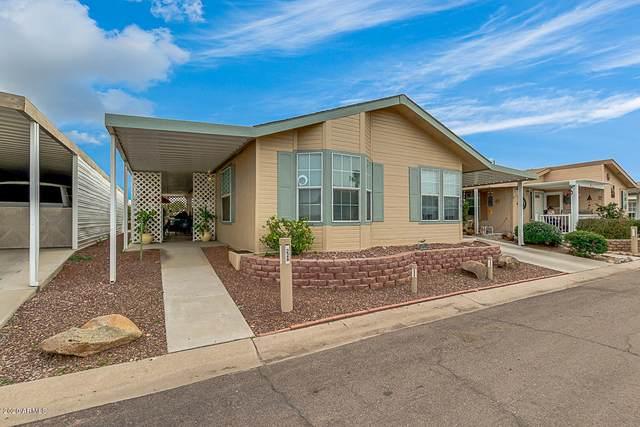11411 N 91ST Avenue #228, Peoria, AZ 85345 (MLS #6082084) :: The Laughton Team
