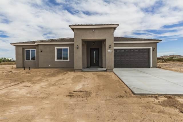 11718 S 204TH Drive, Buckeye, AZ 85326 (MLS #6084726) :: Devor Real Estate Associates