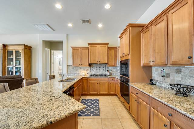 8410 N 180TH Drive, Waddell, AZ 85355 (MLS #6089608) :: Klaus Team Real Estate Solutions