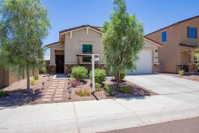1981 N 214TH Lane, Buckeye, AZ 85396 (MLS #6096388) :: Devor Real Estate Associates