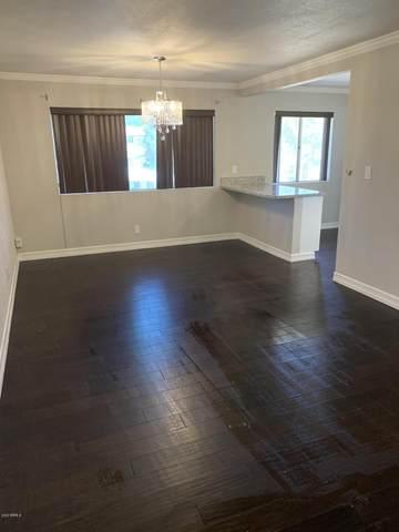 8221 E Garfield Street #207, Scottsdale, AZ 85257 (MLS #6097181) :: The Daniel Montez Real Estate Group
