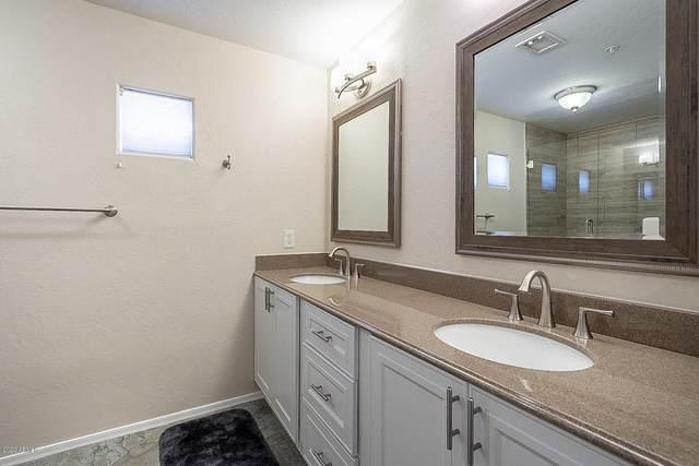 9100 E Raintree Drive #103, Scottsdale, AZ 85260 (MLS #6110638) :: Brett Tanner Home Selling Team