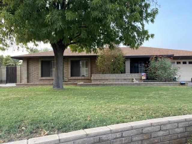 5538 W North Lane, Glendale, AZ 85302 (MLS #6133316) :: Devor Real Estate Associates