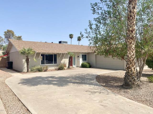 8414 E Crestwood Way, Scottsdale, AZ 85250 (MLS #6134017) :: Riddle Realty Group - Keller Williams Arizona Realty
