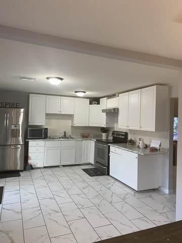 7118 W Mackenzie Drive, Phoenix, AZ 85033 (MLS #6137617) :: Riddle Realty Group - Keller Williams Arizona Realty