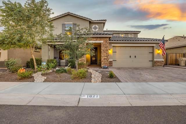 1822 N 214TH Lane, Buckeye, AZ 85396 (MLS #6165211) :: Devor Real Estate Associates
