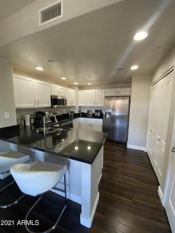21320 N 56TH Street #2042, Phoenix, AZ 85054 (MLS #6182384) :: Devor Real Estate Associates