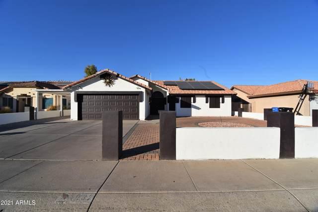 1932 E Alta Vista Road, Phoenix, AZ 85042 (MLS #6182612) :: Yost Realty Group at RE/MAX Casa Grande