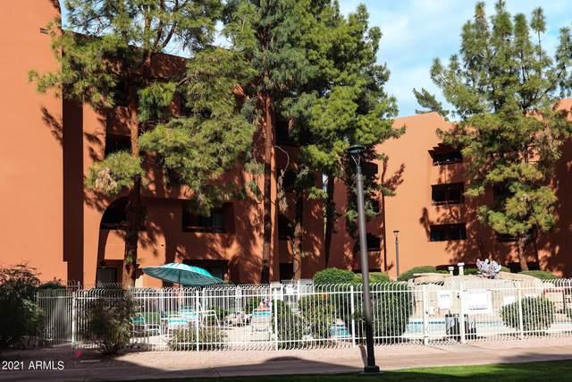 12212 N Paradise Village Parkway S #111, Phoenix, AZ 85032 (MLS #6185321) :: BVO Luxury Group