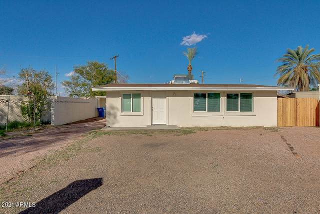 1342 E Burgess Lane, Phoenix, AZ 85042 (MLS #6195164) :: Yost Realty Group at RE/MAX Casa Grande
