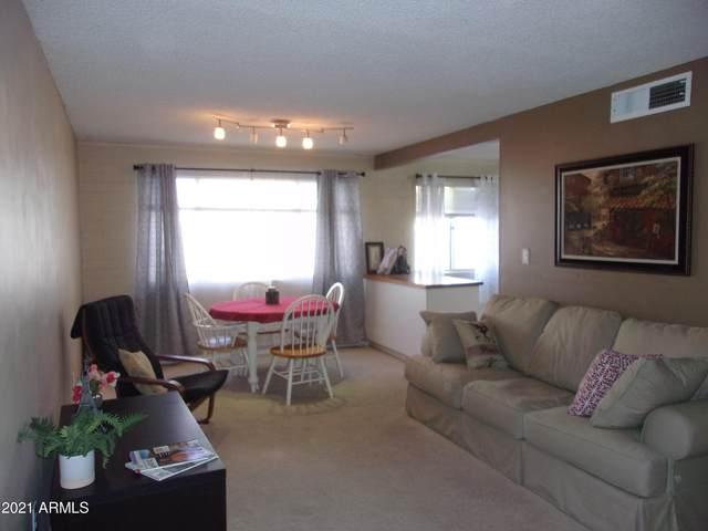 8211 E Garfield Street J109, Scottsdale, AZ 85257 (MLS #6203874) :: The Laughton Team