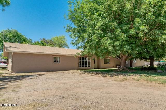 17444 W Mountain View Road, Waddell, AZ 85355 (#6213689) :: Long Realty Company