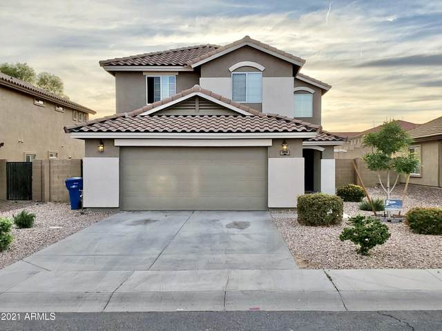 1018 S 222ND Lane, Buckeye, AZ 85326 (MLS #6214974) :: Devor Real Estate Associates