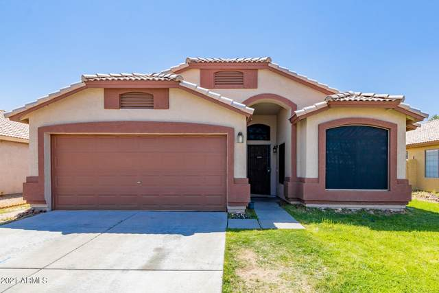 13415 W Desert Lane, Surprise, AZ 85374 (MLS #6217682) :: Yost Realty Group at RE/MAX Casa Grande