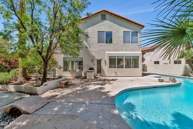 5050 E Paseo Way, Phoenix, AZ 85044 (MLS #6227853) :: Yost Realty Group at RE/MAX Casa Grande