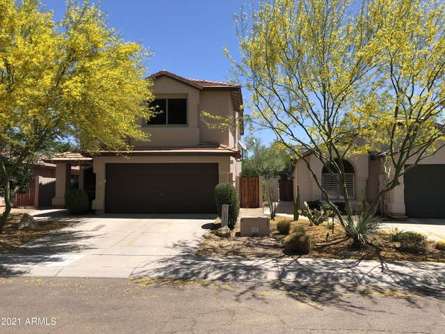 21825 N 48th Place, Phoenix, AZ 85054 (MLS #6233332) :: Yost Realty Group at RE/MAX Casa Grande