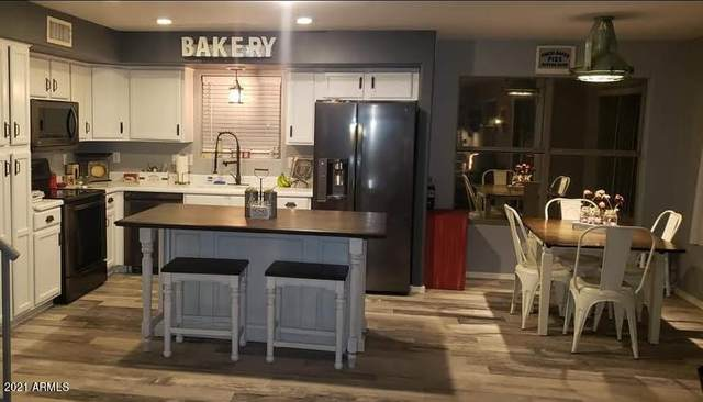 9824 E Onza Avenue, Mesa, AZ 85212 (MLS #6237570) :: Yost Realty Group at RE/MAX Casa Grande