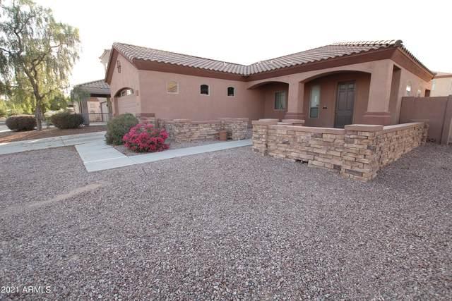 25256 W Parkside Lane, Buckeye, AZ 85326 (MLS #6246292) :: Yost Realty Group at RE/MAX Casa Grande
