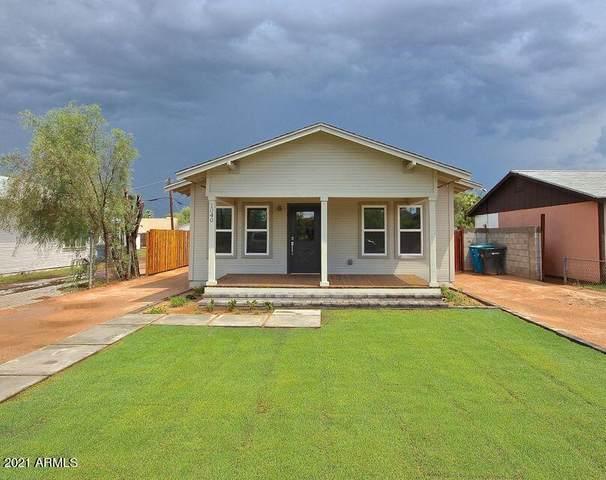 1040 E Palm Lane, Phoenix, AZ 85006 (MLS #6247815) :: Yost Realty Group at RE/MAX Casa Grande