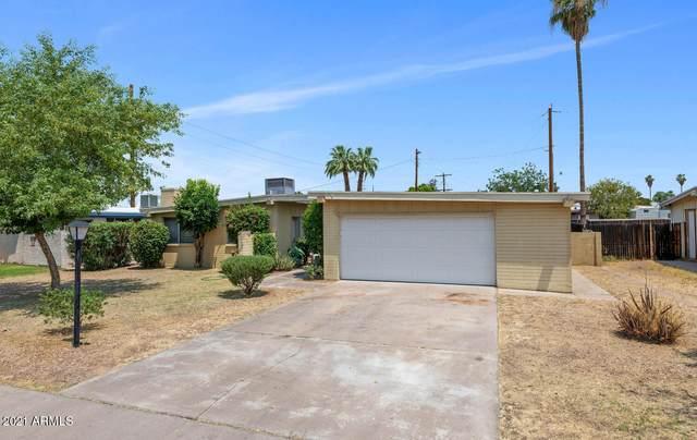 3834 W Golden Lane, Phoenix, AZ 85051 (MLS #6252573) :: Yost Realty Group at RE/MAX Casa Grande