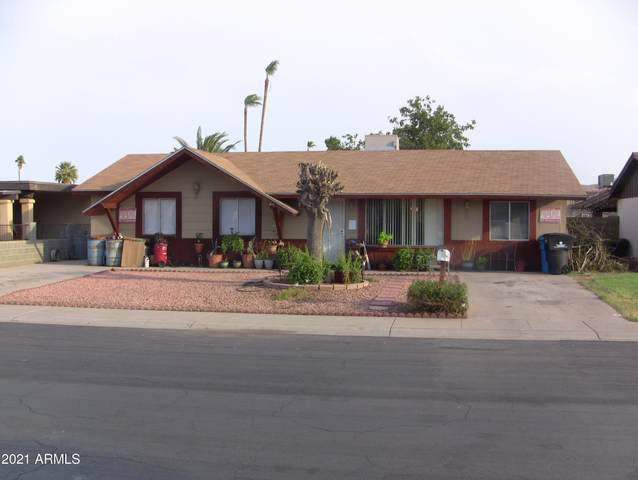 4301 E Saint Catherine Avenue, Phoenix, AZ 85042 (MLS #6259770) :: The Laughton Team