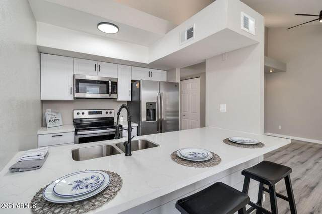 1241 N 48TH Street #204, Phoenix, AZ 85008 (MLS #6259830) :: Long Realty West Valley