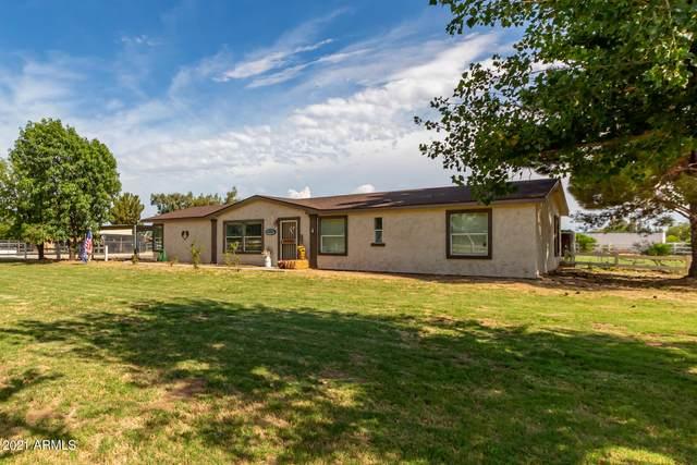 17605 W Glendale Avenue, Waddell, AZ 85355 (MLS #6259932) :: Yost Realty Group at RE/MAX Casa Grande