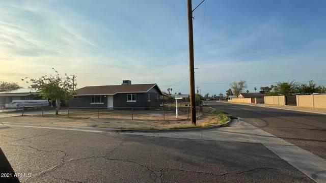 1742 E Burgess Lane, Phoenix, AZ 85042 (MLS #6267807) :: Yost Realty Group at RE/MAX Casa Grande