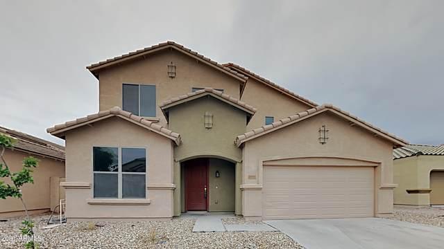 10124 W Raymond Street, Tolleson, AZ 85353 (#6270590) :: The Josh Berkley Team