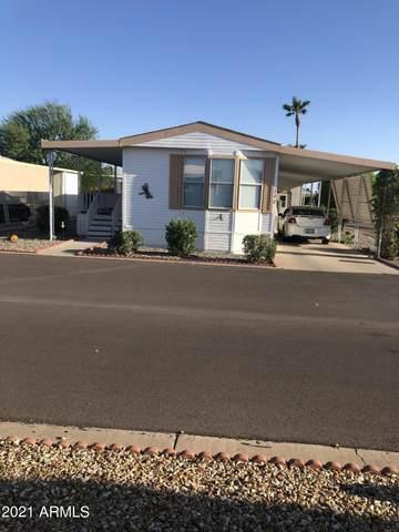 11596 W Sierra Dawn Boulevard #122, Surprise, AZ 85378 (MLS #6273674) :: Long Realty West Valley