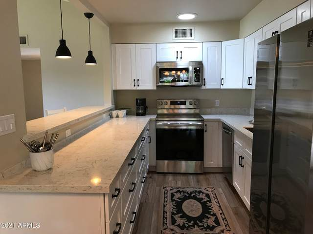 4800 N 68TH Street #216, Scottsdale, AZ 85251 (MLS #6273897) :: The Property Partners at eXp Realty