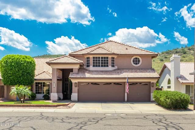 5933 W Calle Lejos, Glendale, AZ 85310 (MLS #6281827) :: Power Realty Group Model Home Center