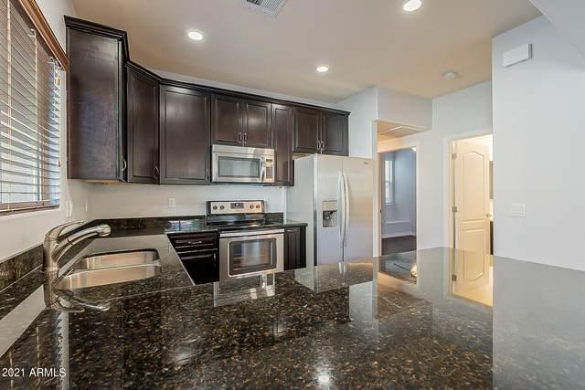 7726 E Baseline Road #112, Mesa, AZ 85209 (MLS #6284004) :: Executive Realty Advisors