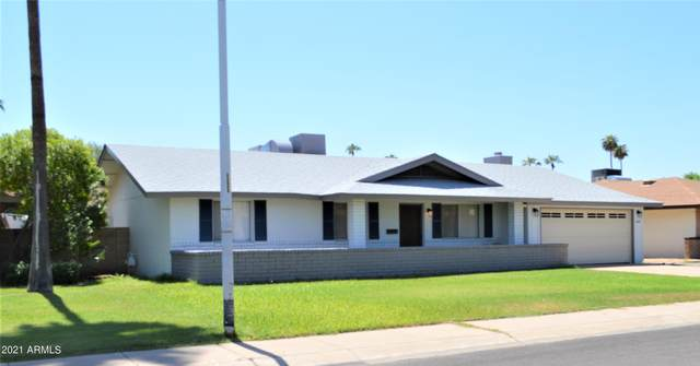 4141 W Linger Lane, Phoenix, AZ 85051 (MLS #6287329) :: Yost Realty Group at RE/MAX Casa Grande