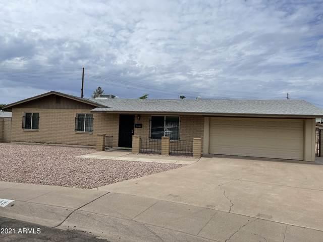 9048 N 38th Drive, Phoenix, AZ 85051 (MLS #6288095) :: Yost Realty Group at RE/MAX Casa Grande