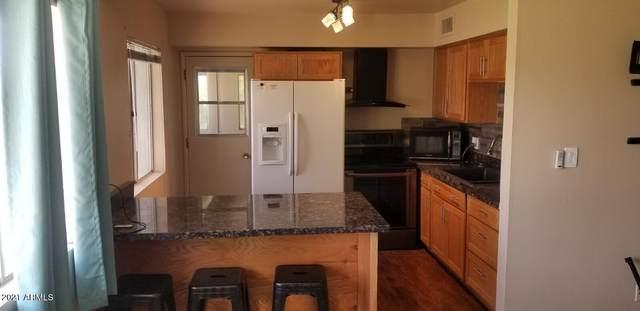 8221 E Garfield Street L213, Scottsdale, AZ 85257 (MLS #6290419) :: Executive Realty Advisors