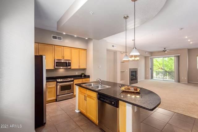 6745 N 93RD Avenue #1106, Glendale, AZ 85305 (MLS #6290721) :: Yost Realty Group at RE/MAX Casa Grande